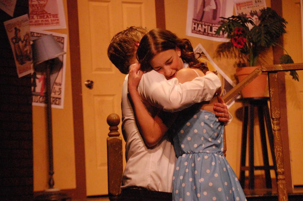 Celeste Arruda and Jon Darga's characters hug each other.