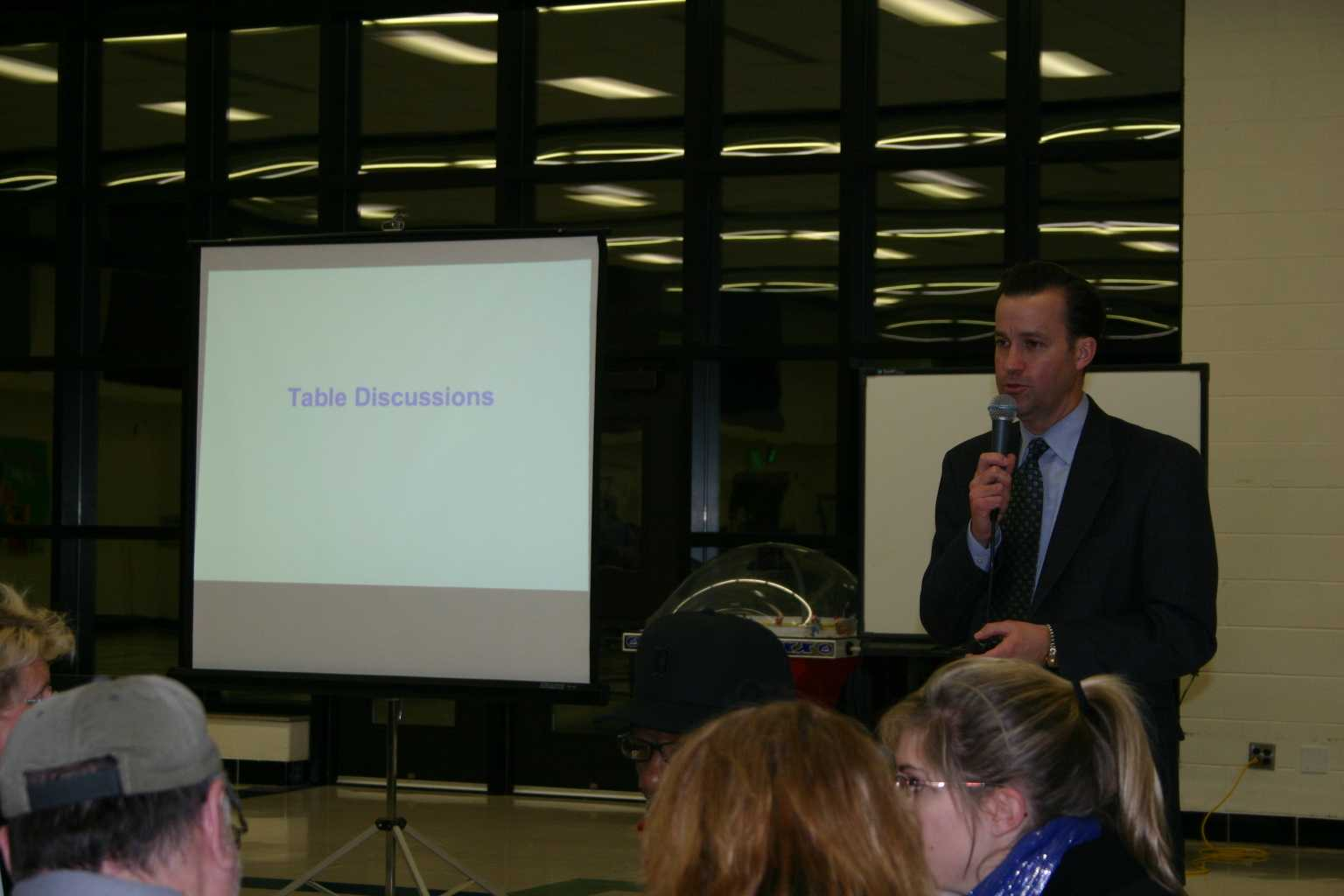 Dr. Roberts discusses the proposed budget cuts at a budget forum meeting on January 14th.