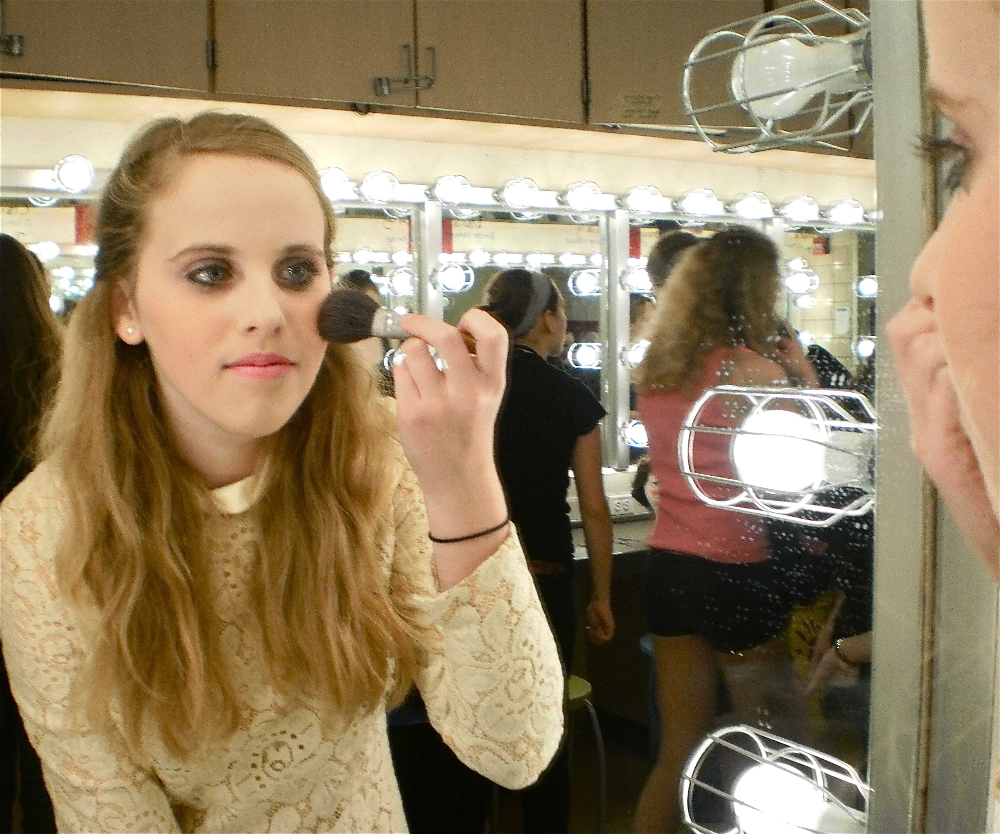 Abby Lauer, a CHS freshman, gets ready backstage for Pioneer Theater Guild's Hairspray.