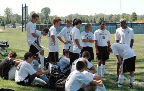 The Huron soccer team listens to their coach, Reese Richardson.