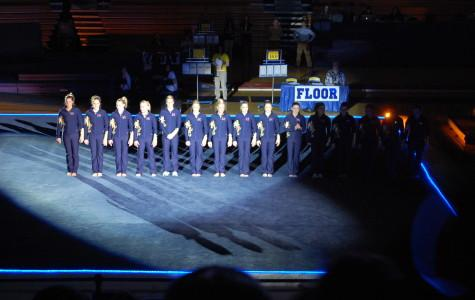 The U of M gymnastics team lined up at the beginning of the meet to sing the star-spangled banner