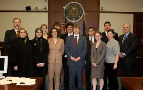 2010 Mock Trial team posses for a picture after defeating Kalamzoo in the state finals.