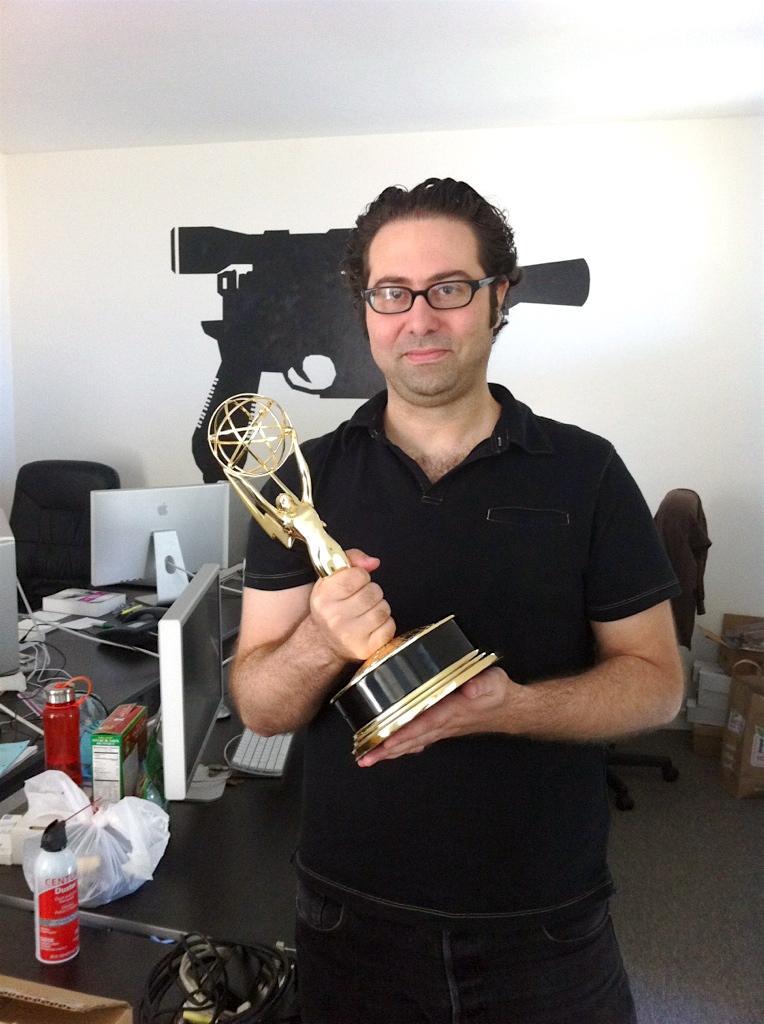 McDermott+holds+up+the+Emmy+award.