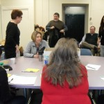 A committee of faculty meets to discuss the lottery at Community High