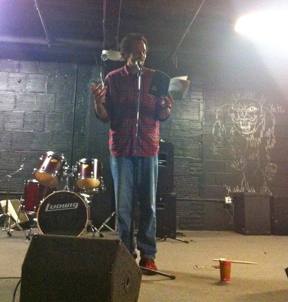 Ross Gay reads one of his poems at the Neutral Zone book release for Red Beard Press's