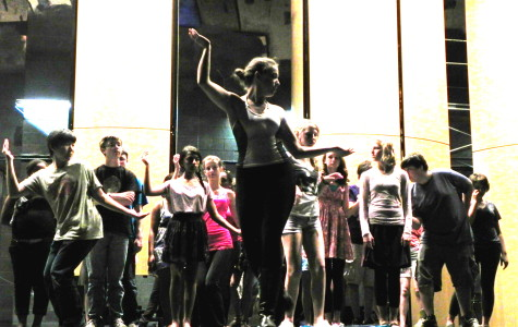 Students rehearse a dance with a University of Michigan student choreographer.