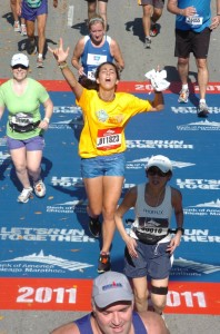 Burgard celebrates her accomplishment as she crosses the finish line.