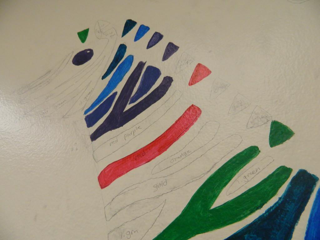LaMoreaux's zebra mural halfway through production