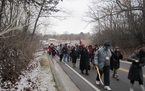 Protesterrs march towards Rick Snyder's home