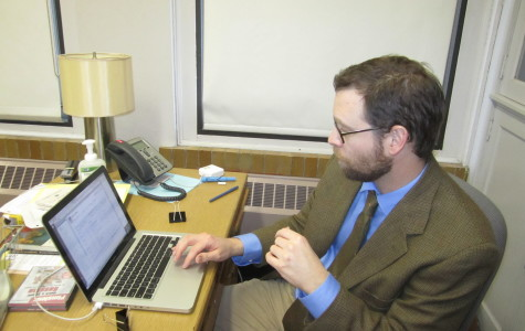 Ken McGraw, soon to be the latest father at Community, finishes up some work at his desk