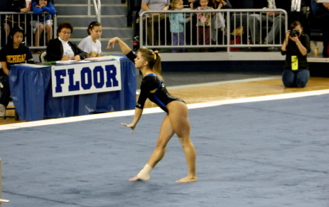 Stephanie Colbert performs on the floor exercise