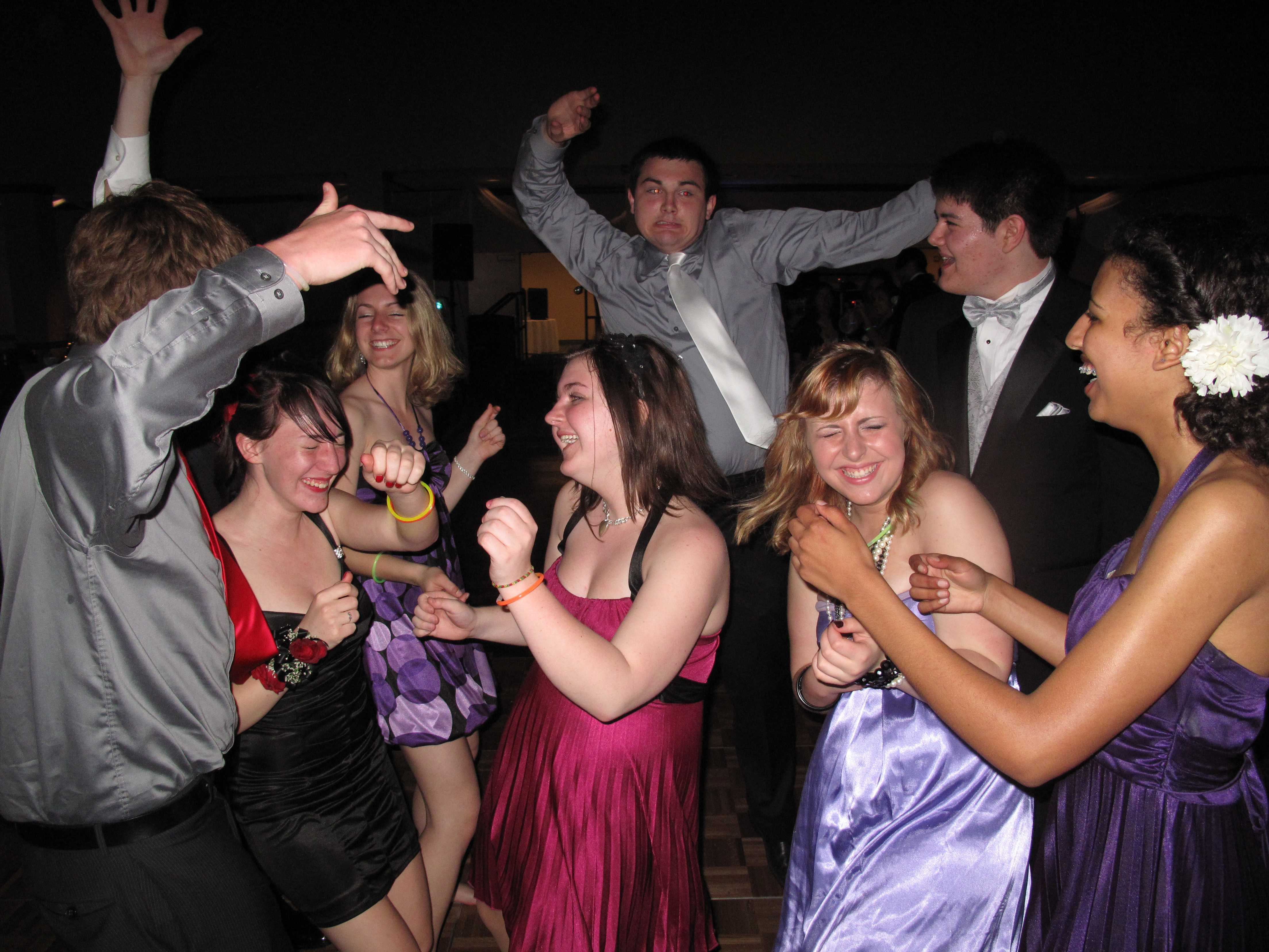 A group of friends dance at the 2011 prom.