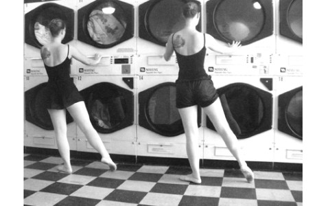 Two ballerinas dance at the Creston Sit-n-Spin Laundry in Grand Rapids, MI.