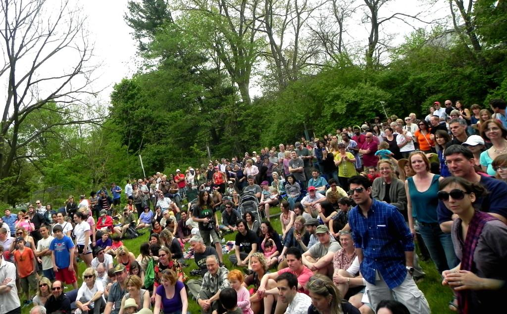 Audience members listen to Ann Arbor based funk band The Macpodzs set at the Water Hill Music Festival.