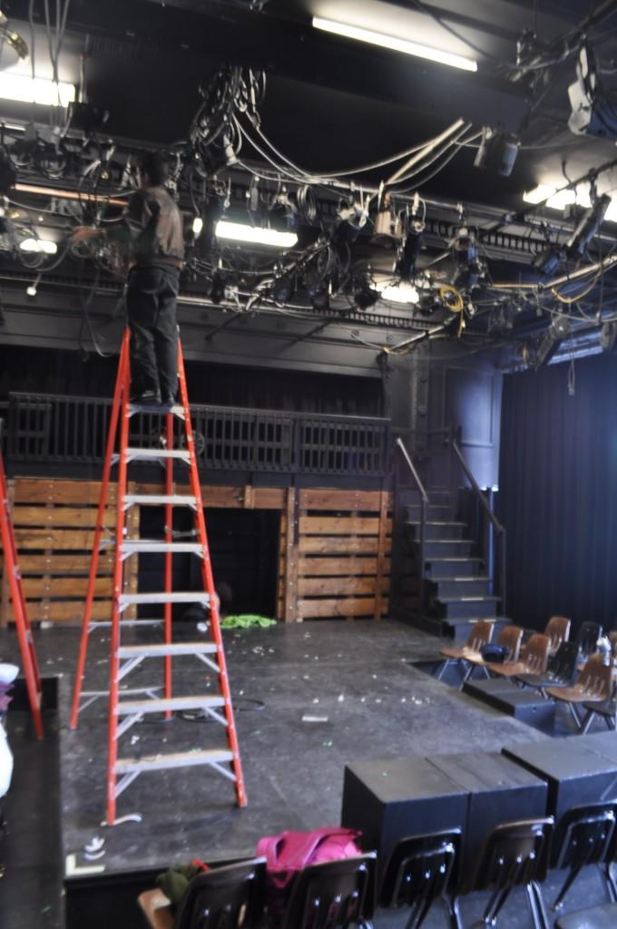 Chris Hoban, lights crew head for Evita, works on the set for opening night.