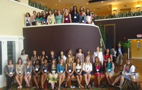 The 2012 Joyce Ivy Foundation scholars with leader of the year Deanna Mulligan at the college symposium last May.