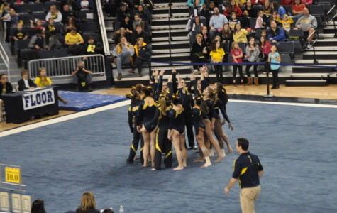 The team prepares for floor, the last rotation of the competition.