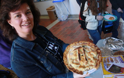 Diane Grant appreciates the artistry of a pie before it is demolished.