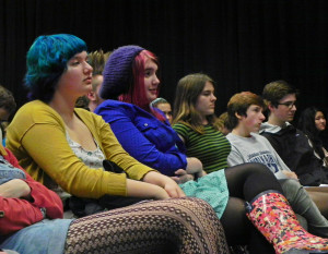 CHS poets listen to other writers and wait for their turn to read onstage