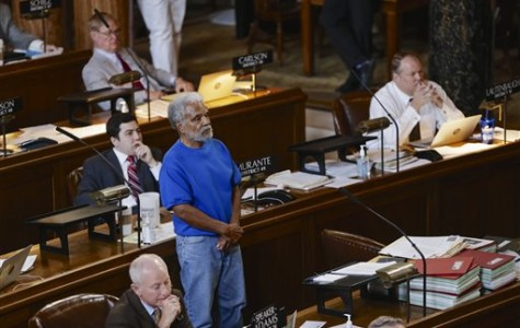Ernie Chambers, Nebraska state senator, stands during debate to repeal the death penalty in Nebraska (AP Photo).