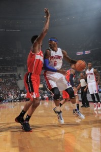 Josh Smith looks to score in his first game as a Piston