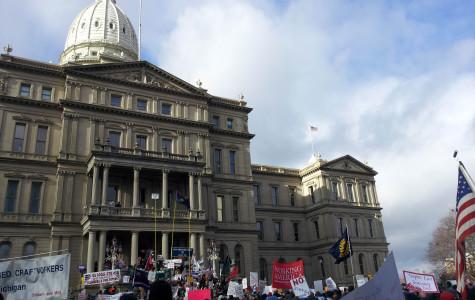 Protestors stand outside the Michigan Capitol building Dec. 2012.