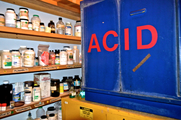 Acid cabinet in the chemistry closet.