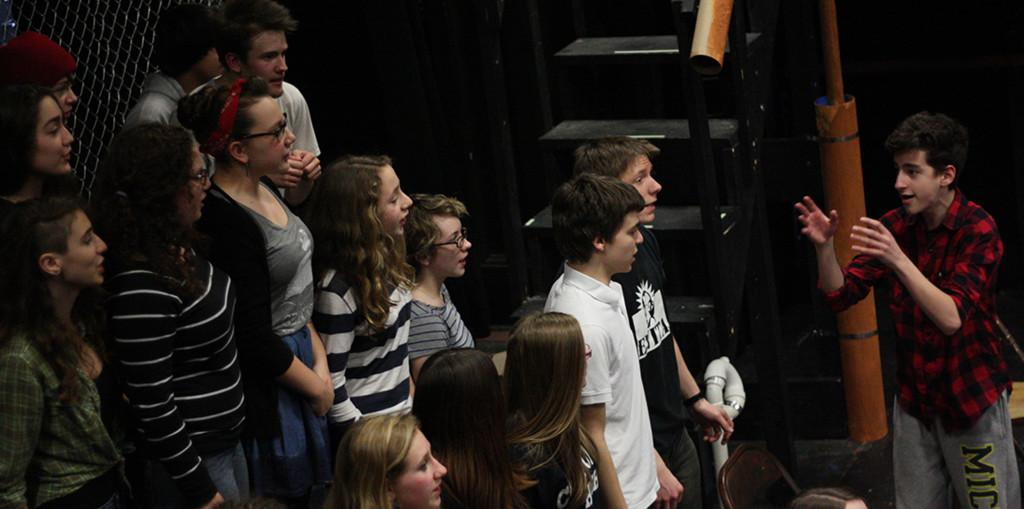 Actors, led by Isaac Scobey-Thal as Bobby Strong, rehearse the song Run Freedom, Run.