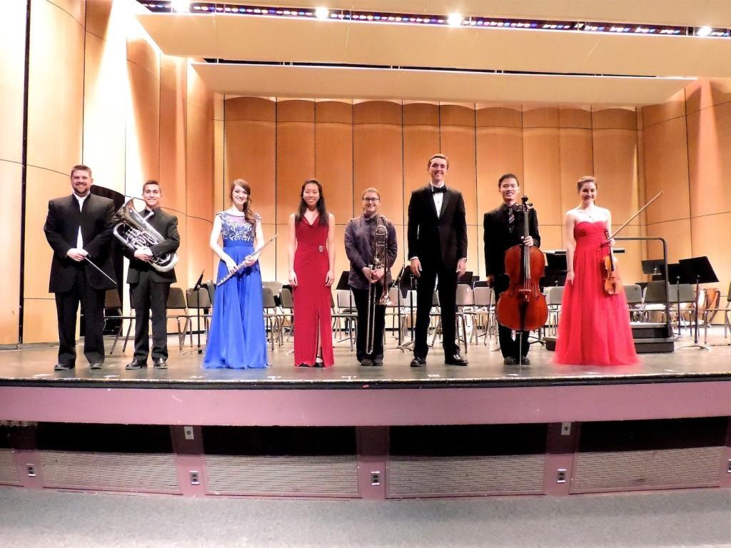 (from left to right) Orchestra director Mr. Glawe, Elliot Polot, Anna Latterner, Sarah Xie, Halley Bass, Sam Kidd, Jin Nakamura, and Emma Sandberg