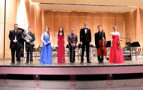 (from left to right) Orchestra director Mr. Glawe, Elliot Polot, Anna Latterner, Sarah Xie, Halley Bass, Sam Kidd, Jin Nakamura, and Emma Sandberg