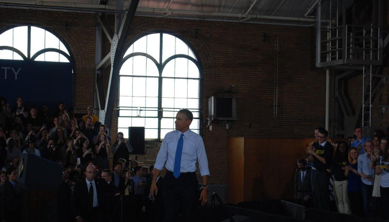 Obama walks off the stage after finishing his speech.