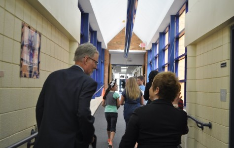 State Superintendent Mike Flanagan (left) and AAPS Superintendent Jeanice Swift (right) walk and talk inside Pattengill.