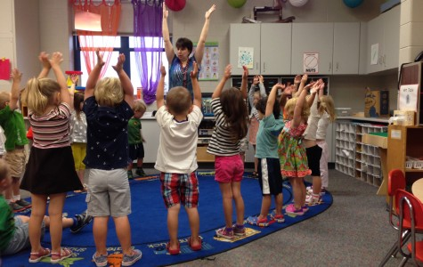 Amy Pufahl dancing with her preschoolers.