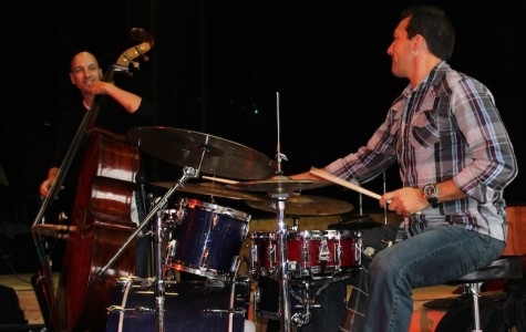 Keith Hall (drums) and Phil Palombi (bass) exchange a glance while jamming.