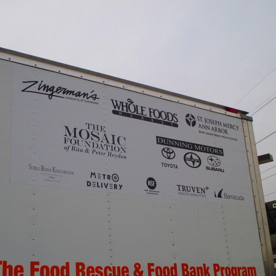 Food Gatherer's Trucks display the many sponsors that fund the organization. Zingerman's (top left) is the founding business that started Food Gatherers. Notice the variety of businesses, both food and non-food donors.