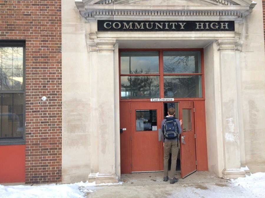 Matthew Ferraro opens the front door to Community High School as an official student after two and a half years of waiting