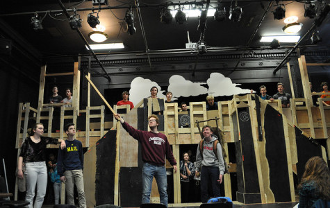Rehearsal a week before opening night. Oren Levin (center left) portrays King Arthur holding Excalibur. Milo Tucker-Meyer (center right) portrays Patsy, servant/steed of King Arthur. Sophia Werthmann (far left) and Isaac Scobey-Thal (second from the left) portray Dennis' widowed mother and Dennis Galahad respectively.