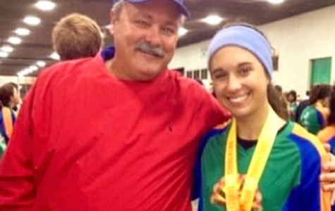 Carlee Faber and her dad, Pat Faber, at a cross country race before Carlee left home to attend Central Michigan University.