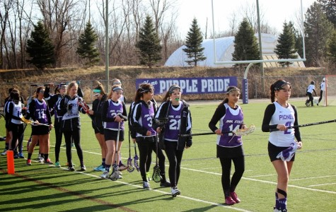 The Pioneer Women's Lacrosse team lining up for a stick check before their game against Skyline.
