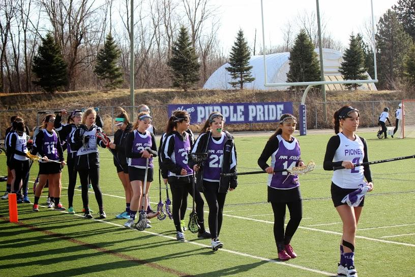 The+Pioneer+Women%27s+Lacrosse+team+lining+up+for+a+stick+check+before+their+game+against+Skyline.+