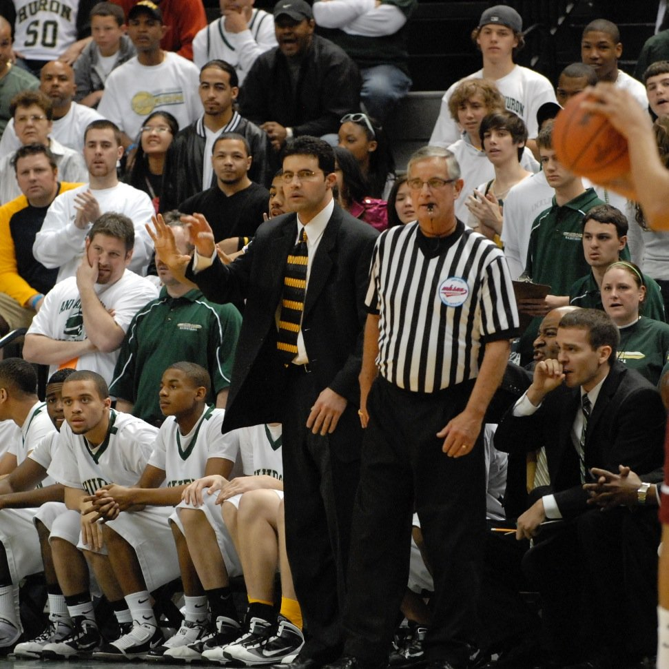 Coach Samah directs his players from the coaching box. In 2010, he led the Huron team to a second place state finish, narrowly losing to Kalamazoo Central 74-65 in the championship match. (Photo courtesy of @HURONBBALL taken from Twitter.)