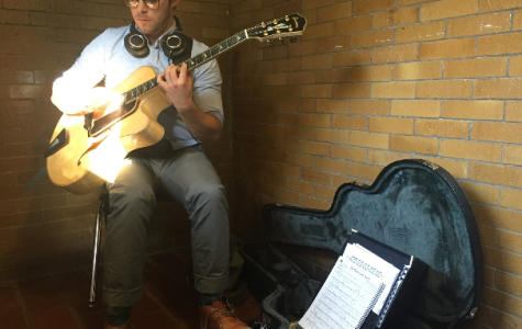 Aidan Cotner sits in the sunlight below the staircase, putting his own twist on Duke Ellington.