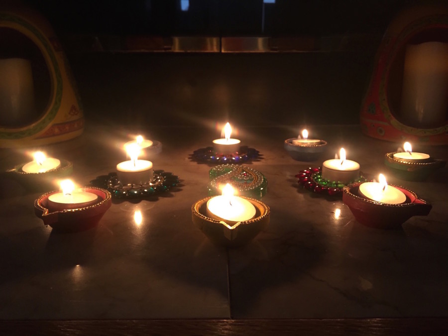 Candles+called+%22diyas%22+lit+for+Diwali+under+a+picture+of+Maha+Lakshmi.