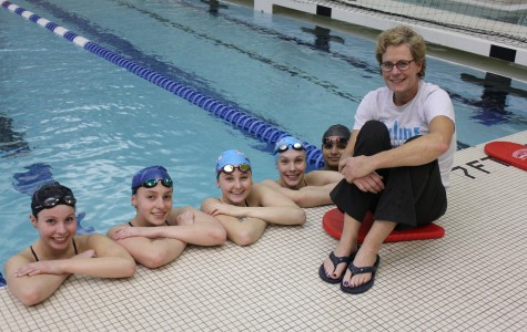 Skyline Women's Swimming head coach, Mojo Isaac, and state team members.