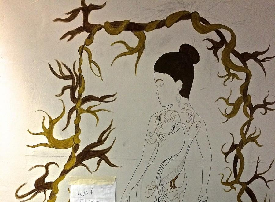 Yellows and browns are currently the prominent color tones in Maddie McCarvers mural. She plans to later add purples and blues.