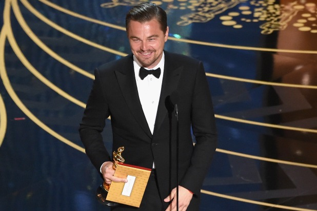 Leonardo DiCaprio finally wins his first Oscar after being nominated four times previously.  He enjoys the moment.