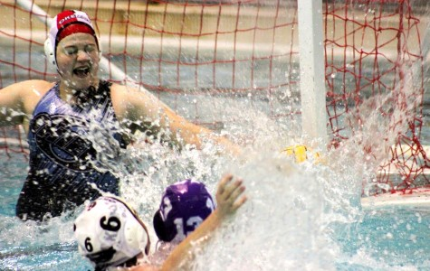 Leah Weingarten, #13 for Pioneer, scores her first goal on Dawn Hakwins, goalie for Okemos, in the third quarter.