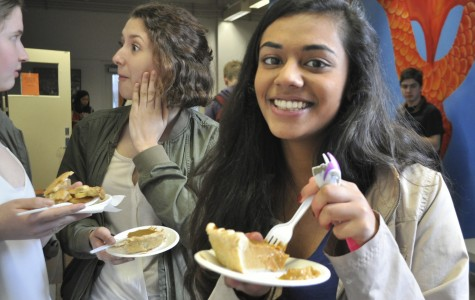 Community High School senior Anurima Kumar grins with her piece of pumpkin pie. Before this, she had a piece of chocolate pie. Kumar is sad that it's her last Pi Day at CHS.