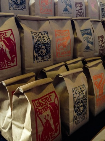 Bags of roasted coffee sit waiting to be purchased.