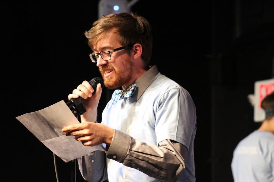 CHS teacher Robert Morgan gives an attendance rap with his forum stomping behind him.